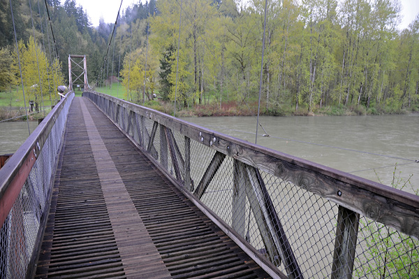 Tolt MacDonald Park suspension bridge walking over Snoqualmie River in Carnation