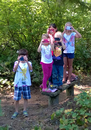 Kids taking pictures with phones along Coastal Forest Trail in Cape Disappointment State Park