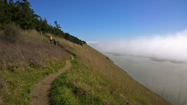 Hiking to top of bluff above Parego's Lagoon in Ebey's Reserve of Coupeville on Whidbey Island