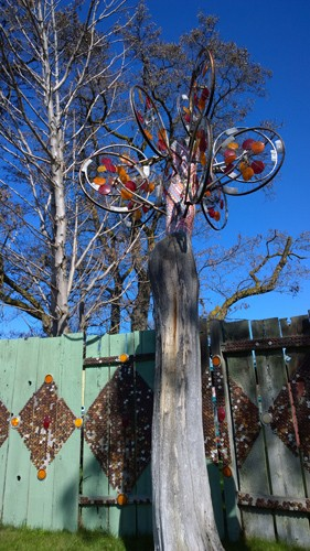 Dick and Janes Spot Ellensburg bike wheel reflectors on tree  wind sculpture