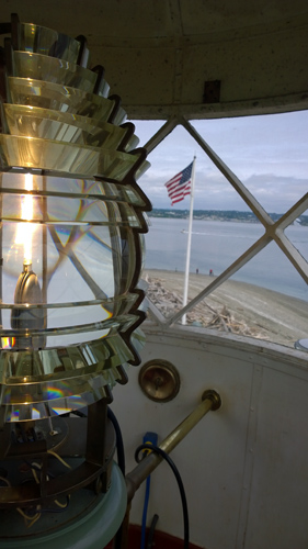 Light and American flag from Point Robinson Lighthouse at Point Robinson Park on Maury Island by Vashon Island