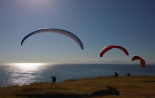 Fort Ebey State Park 3 paragliders at bluff edge overlooking Strait of Juan de Fuca