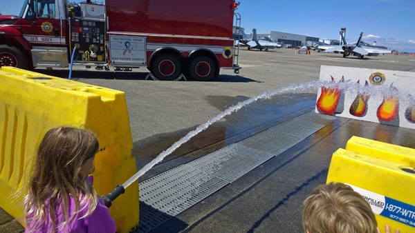 Children spraying real fire hose at Naval Air Station Whidbey Island Open House Oak Harbor