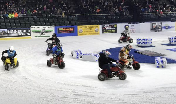 Ice Racing Championship Series 3 wheel ATV trikes in corner at Everett Xfinity Arena