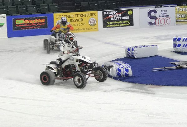 Ice Racing Championship Series 4 wheel ATVs in corner at Everett Xfinity Arena