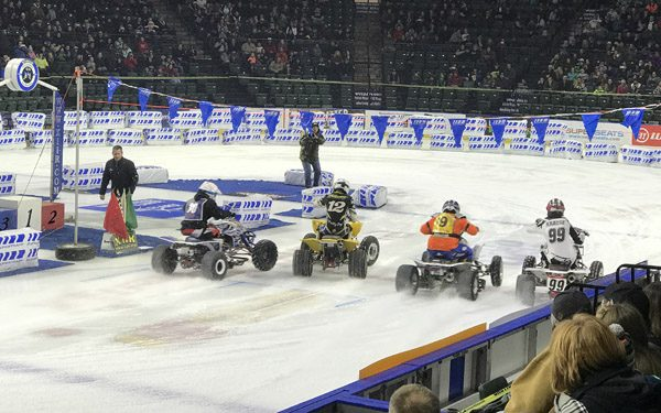Ice Racing Championship Series 4 wheel ATVs launching from starting line at Everett Xfinity Arena