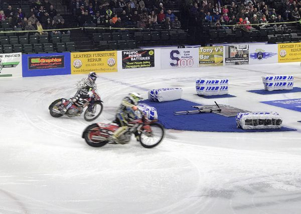Ice Racing Championship Series motorycles sliding in corner at Everett Xfinity Arena