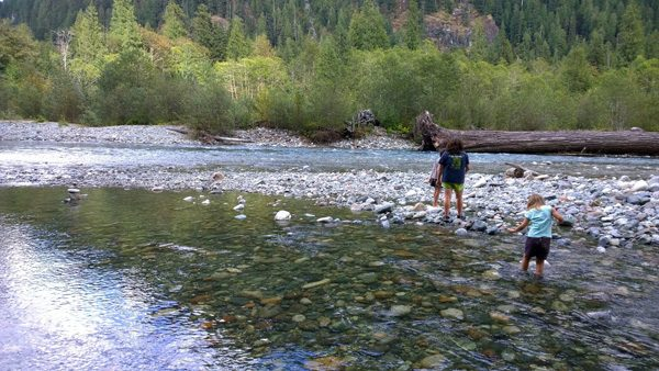 Exploring river and rocks along Baker Lake Trail near Mt Baker