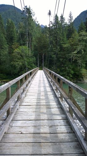 Suspension bridge over Baker River along Baker Lake Trail near Mt Baker