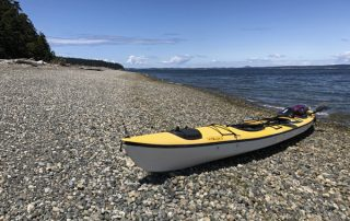 Triple sea kayak on Saratoga Passage beach Coupeville Whidbey Island