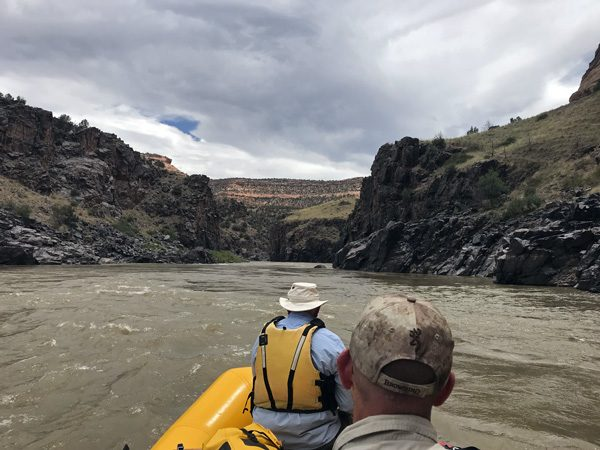 Rafting dark rock walls of Westwater Canyon on Colorado River Utah