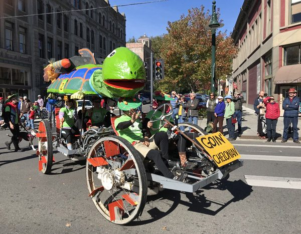Port Townsend Kinetic Sculpture Race parade down on Street with turtle